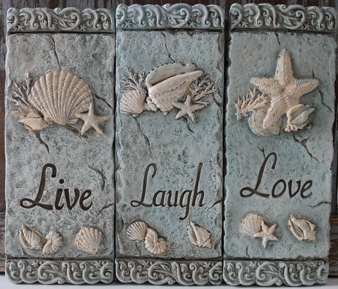 """Set of 3 sea green cement plaques ordained with raised white sea life carvings, intricate decorative borders, and engraved with the classic words Live, Laugh, and Love. Each plaque measures 8"""" x 3"""" - Coastal Beach Decor - California Seashell Company"""