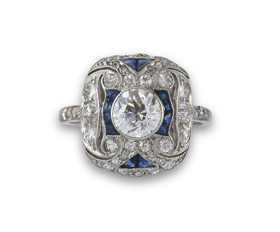 Edwardian sapphire and diamond pierced rectangular panel ring with diamond collet centre