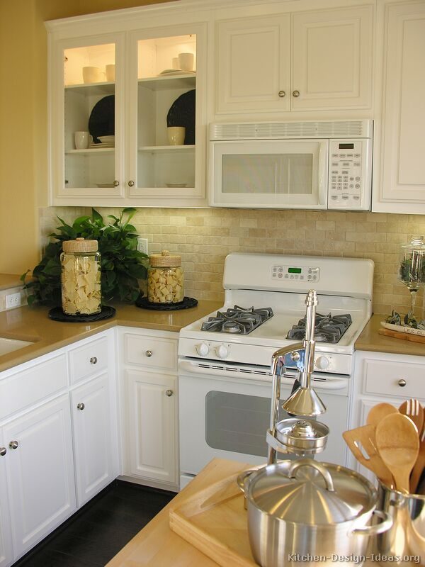 traditional white kitchen cabinets with white appliances
