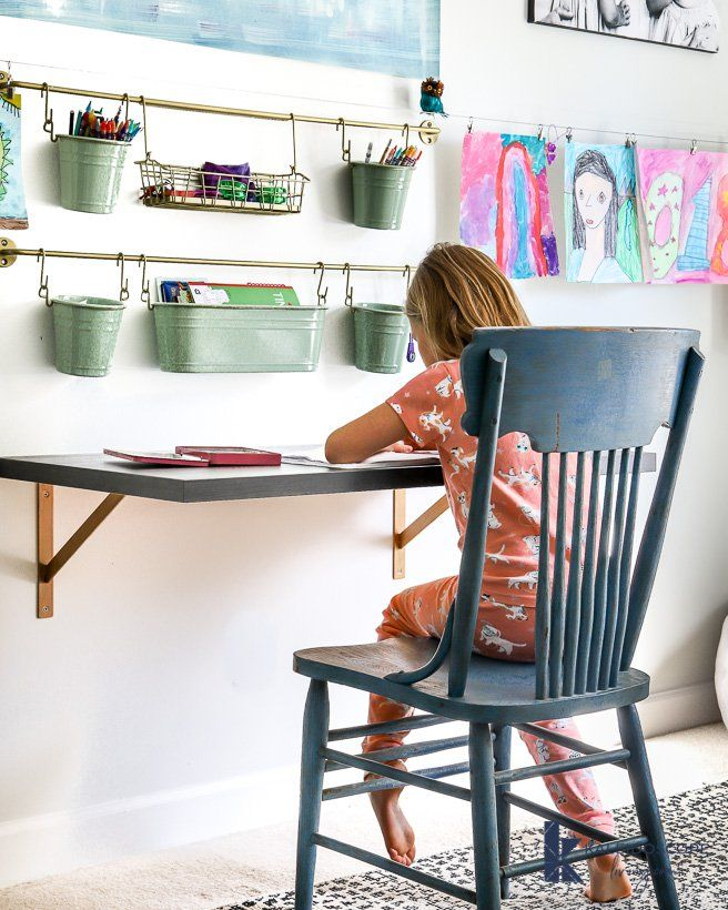 Looking for an affordable desk option that doesn't take up a ton of room and is easy to make? This DIY desk is your answer! It looks great with any decor style and it's easy enough for inexperienced DIYers. #DIYdesk #DIYdeskcheap #DIYdeskeasy #DIYdeskdecor #DIYdeskkids #DIYdesksimple #bedroomdesk #kidsroomideas #deskideas #bedroom #desk #office #floatingdesk