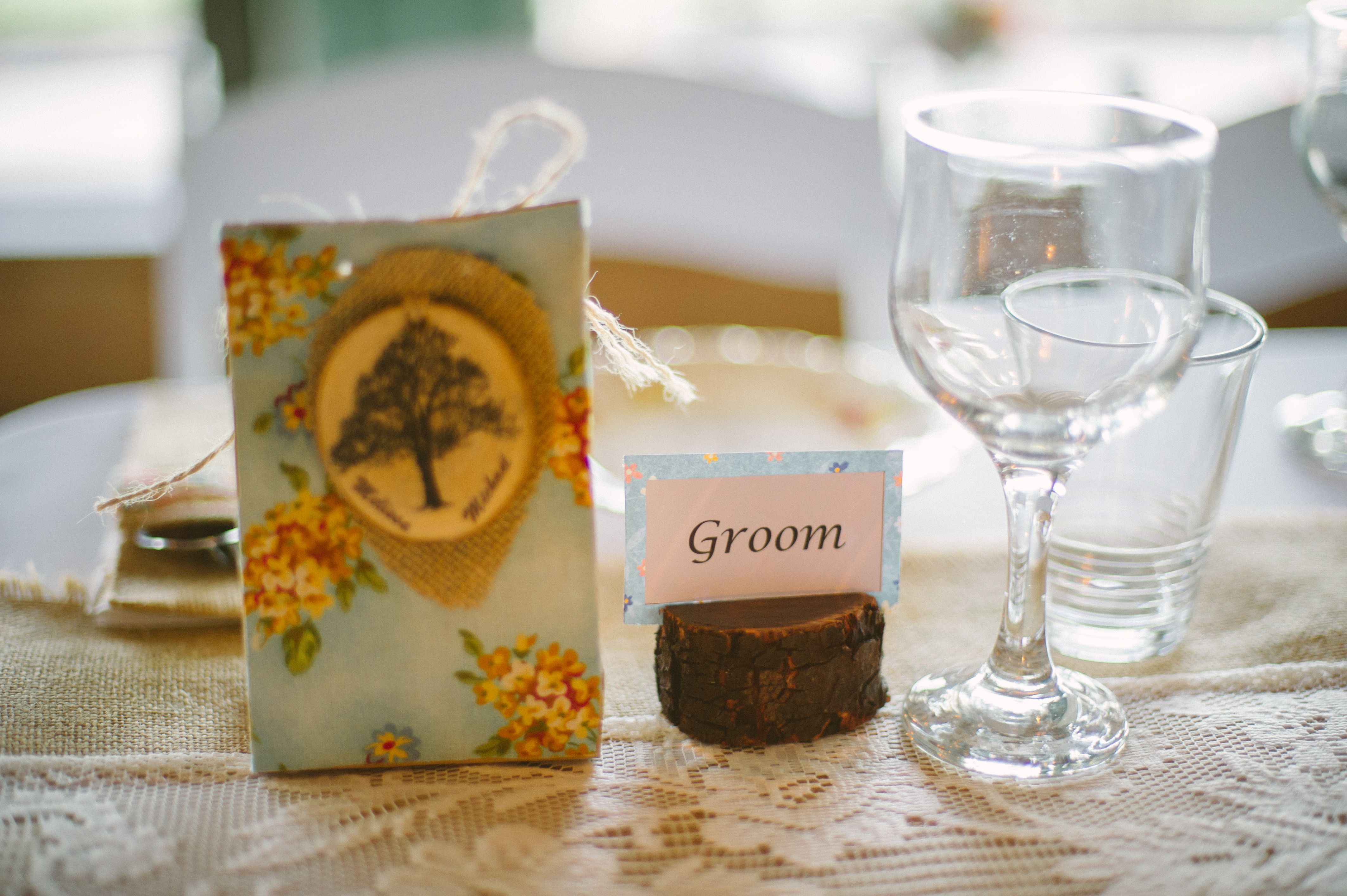 Wedding Reception Decor: I hand made the table decorations including the table setting cards and the favours which were filled with mini choc chip cookies.