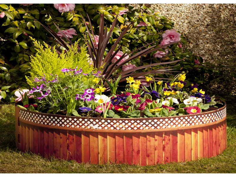 Interesting Flower Garden Ideas With Round Cedar Wood Raised Bed As Well As Raised  Gardens Designs