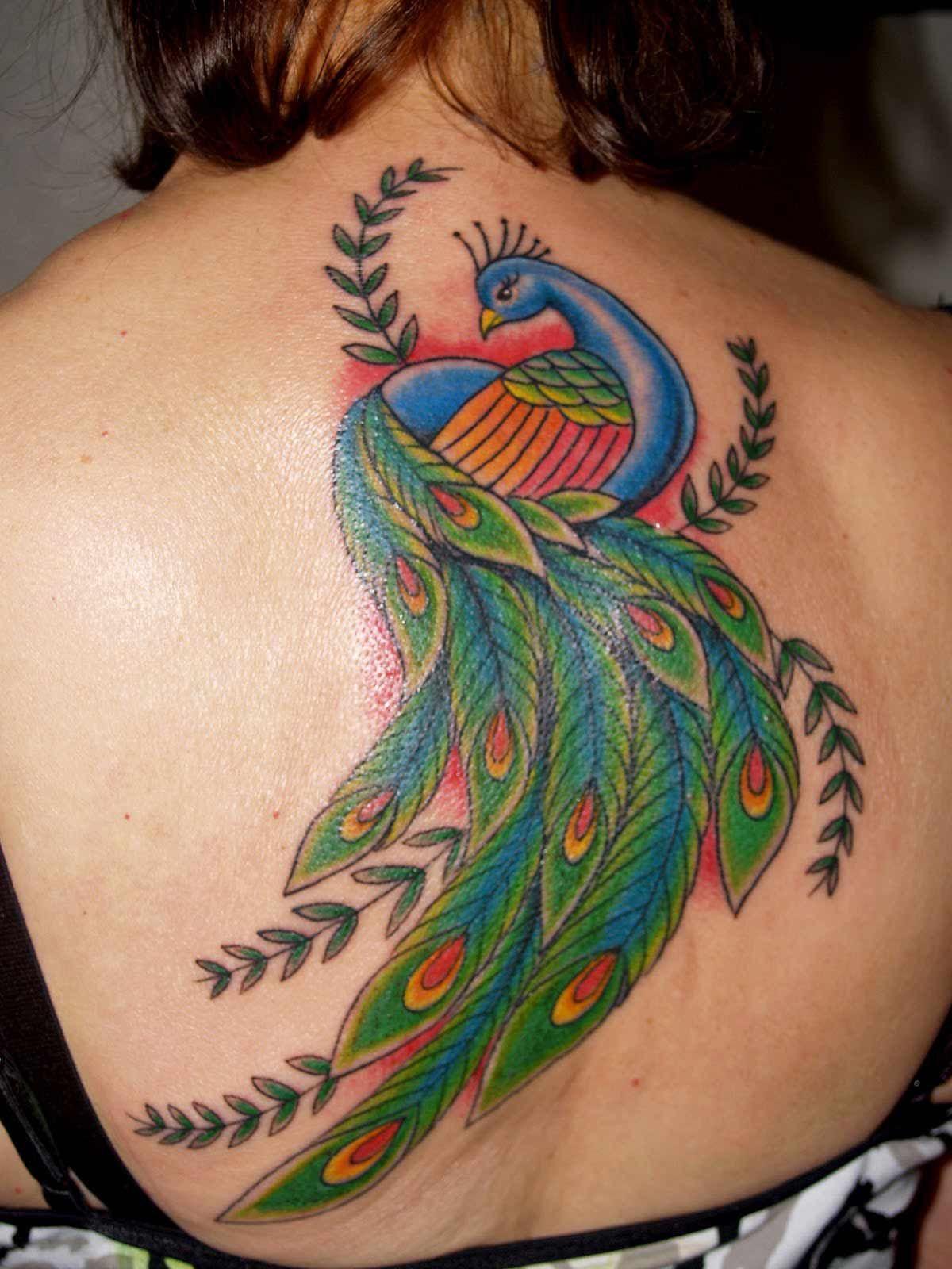 Big peacock tatoo on full hand for womens Peacock tattoo
