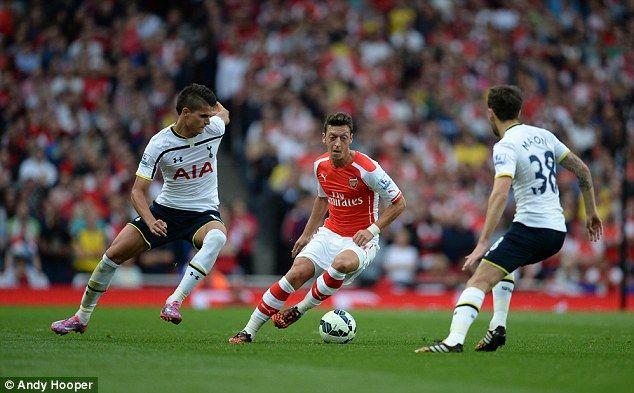 Arsenal S Mesut Ozil Keeps Tight Control Of The Ball Under Pressure From Spurs Erik Lamel Tottenham Arsenal Arsenal Photo