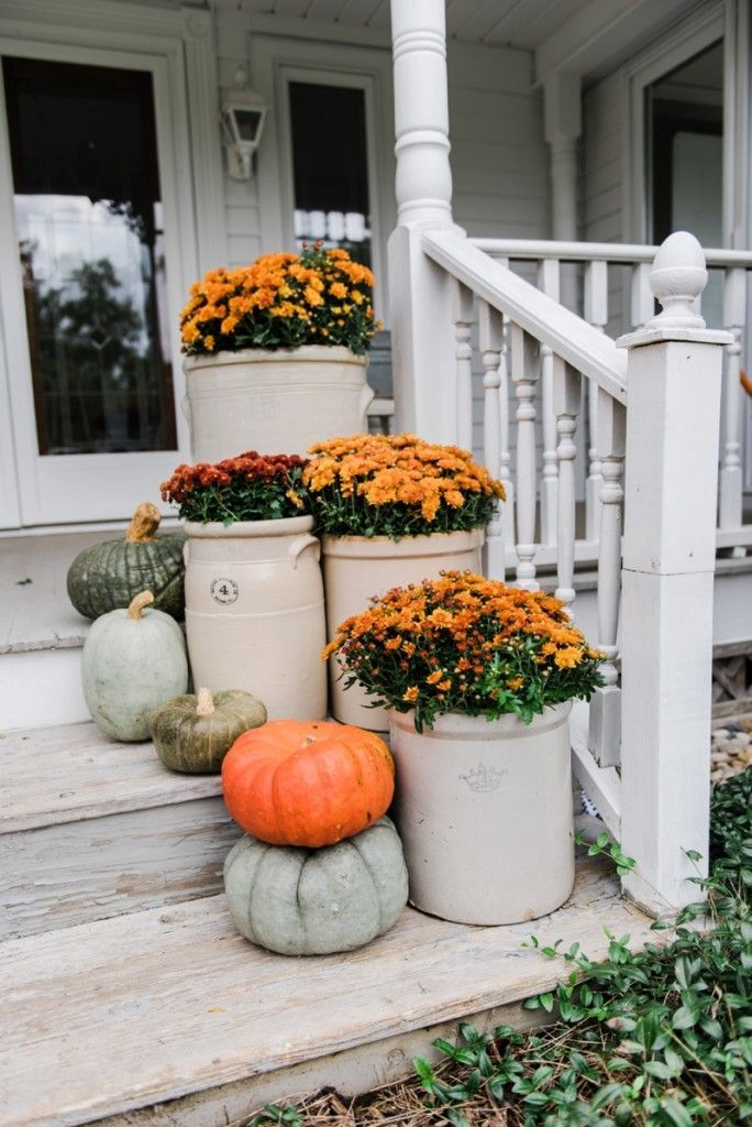 cozy rustic fall porch mums in crocks to give a farmhouse porch an instant fall vibe great source for farmhouse decor - Farmhouse Garden Decor