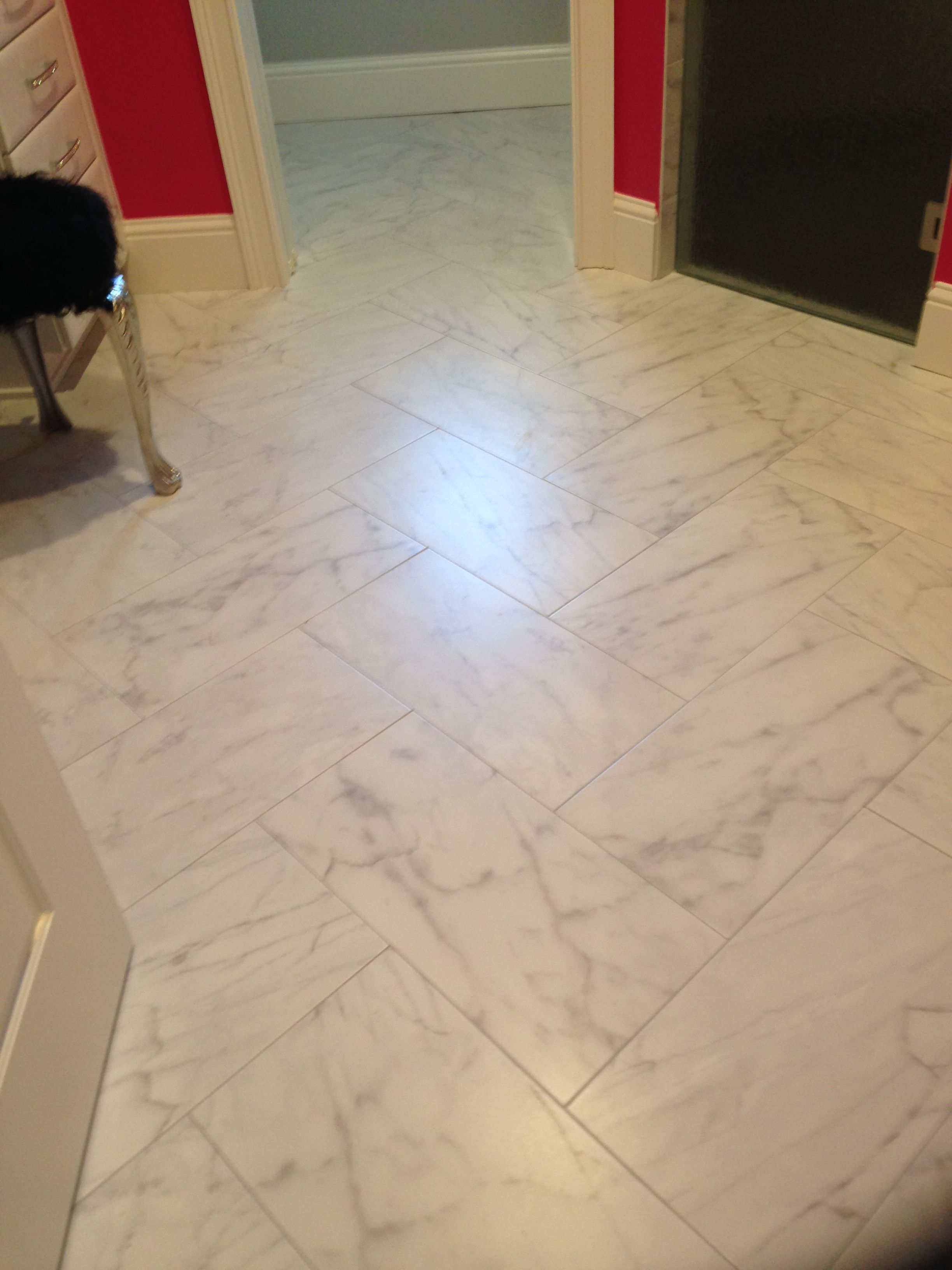 12 X 24 Carrara Look Porcelain Tile In Herringbone Pattern Herringbone Tile Floors Flooring Patterned Floor Tiles