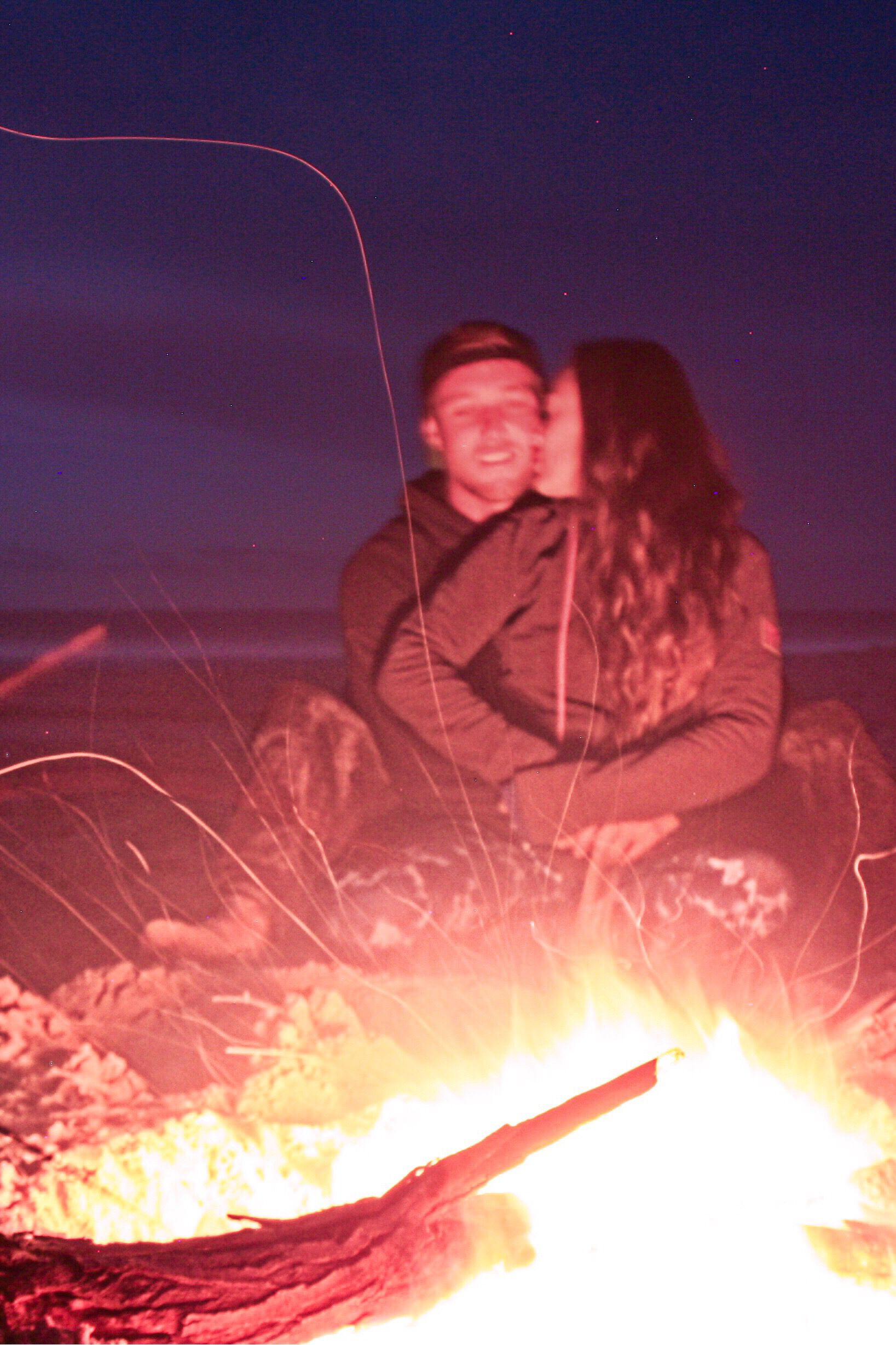 Travel couple photo, beach fire, camping in Western ...