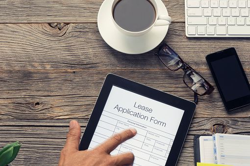 Online lease application form with pointing finger Astronaut - lease application