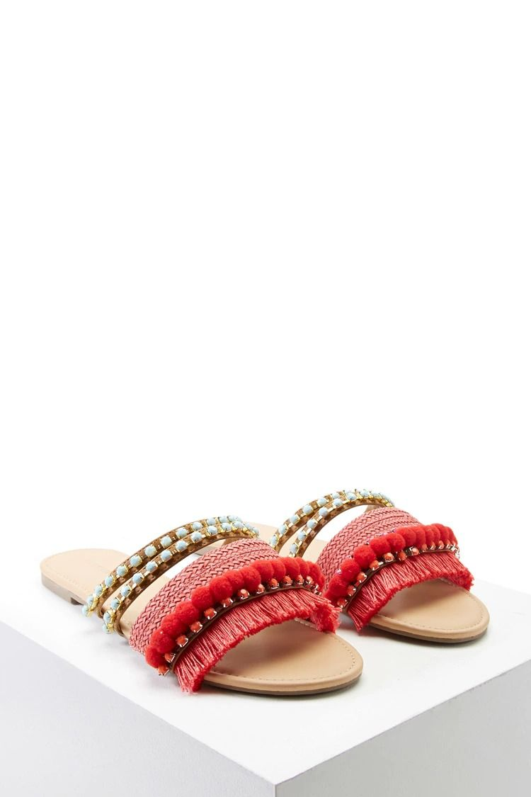 ddeee36f79512e A pair of faux leather sandals featuring a strappy design with faux gems