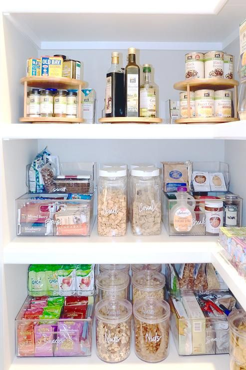 Chic Pantry With Tiered Lazy Susan Spice Racks Transitional Kitchen The Home Edit Pantry Organisation Home Organization