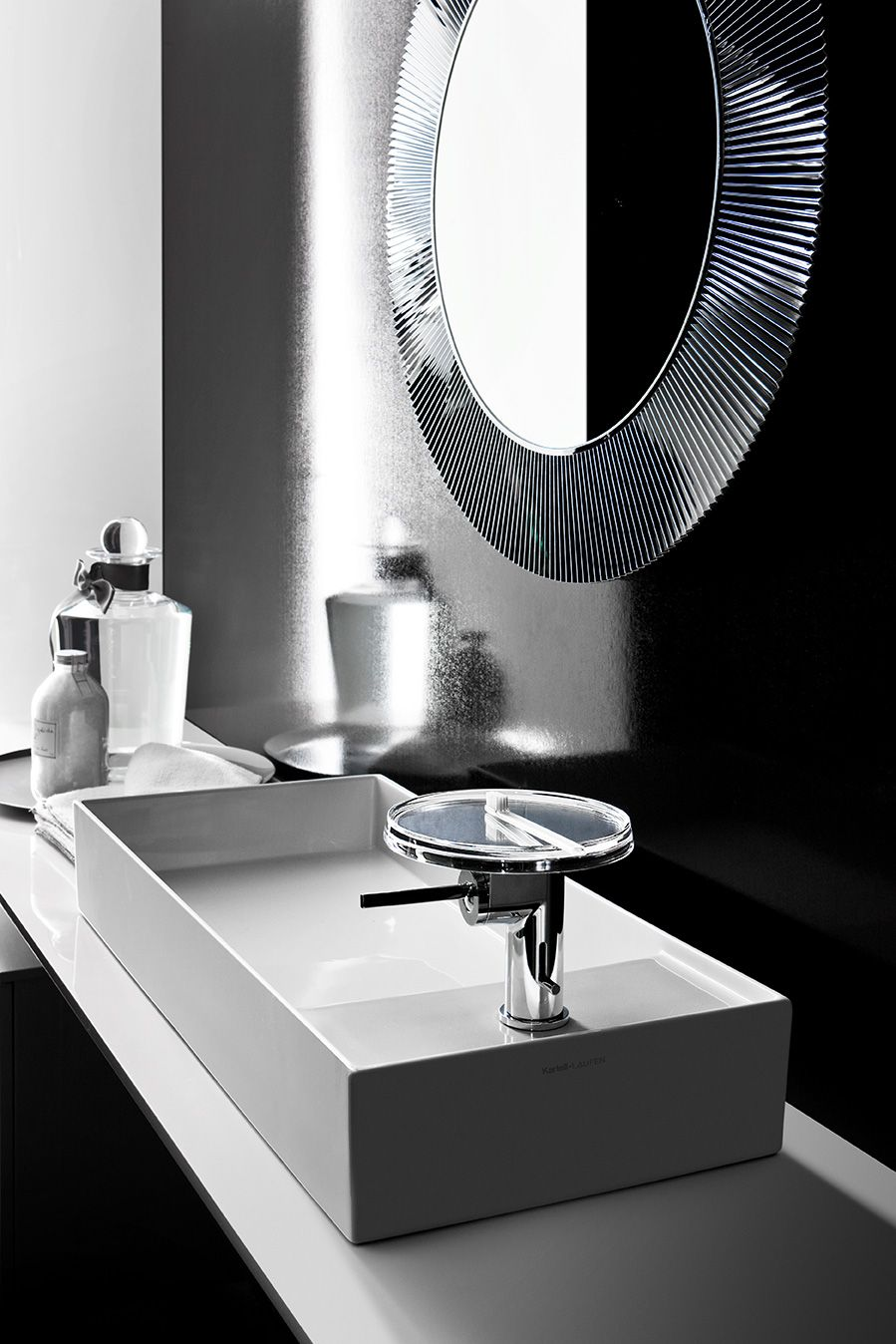 GREY BATHROOM  The rigid geometry of the ceramic items is tempered by the multicoloured lightness of the transparent plastic elements. Leaving aside primary colours Kartell by Laufen sets coloured light horizons into the free area of the house where the senses yield to the emotions.