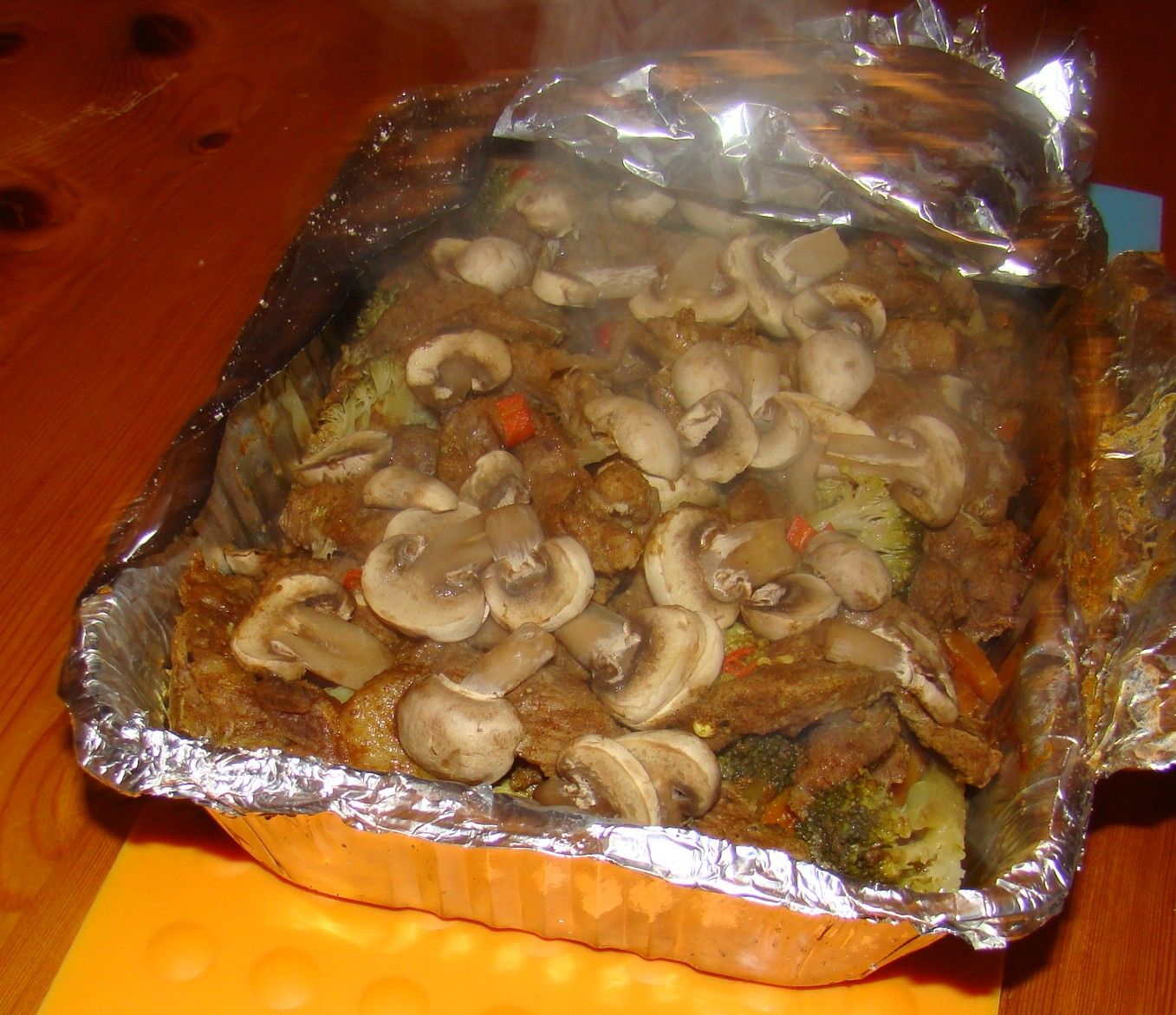 Right - time to get to cooking on the fire! Hereis a favourite dish that we cook on the fire often, andit'sa good example of the type of food we cookwhen camping- a pack of vegetables and meat...