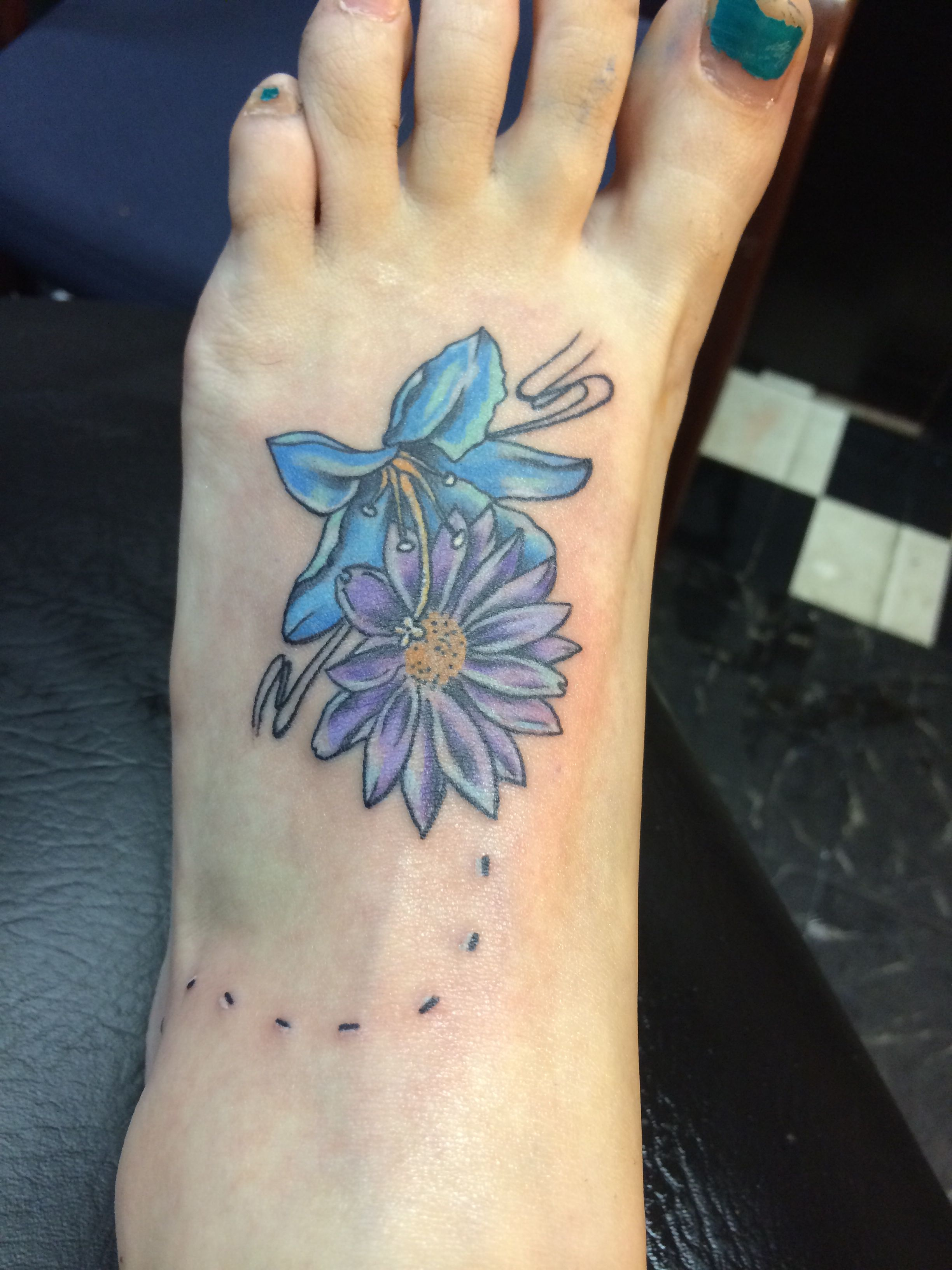 Flower Tattoo On Foot Lily And Daisy Done By Geo At Passionfish In