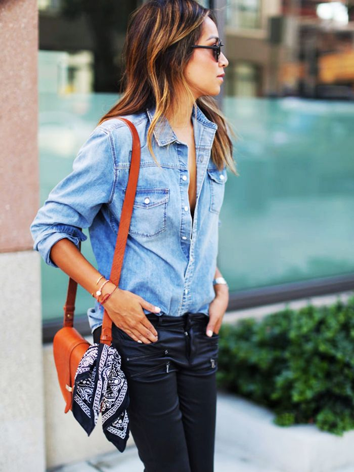 dae04642316 Julie Sariñana of Sincerely Jules wears a denim shirt, leather pants, a  shoulder bag, and bandana