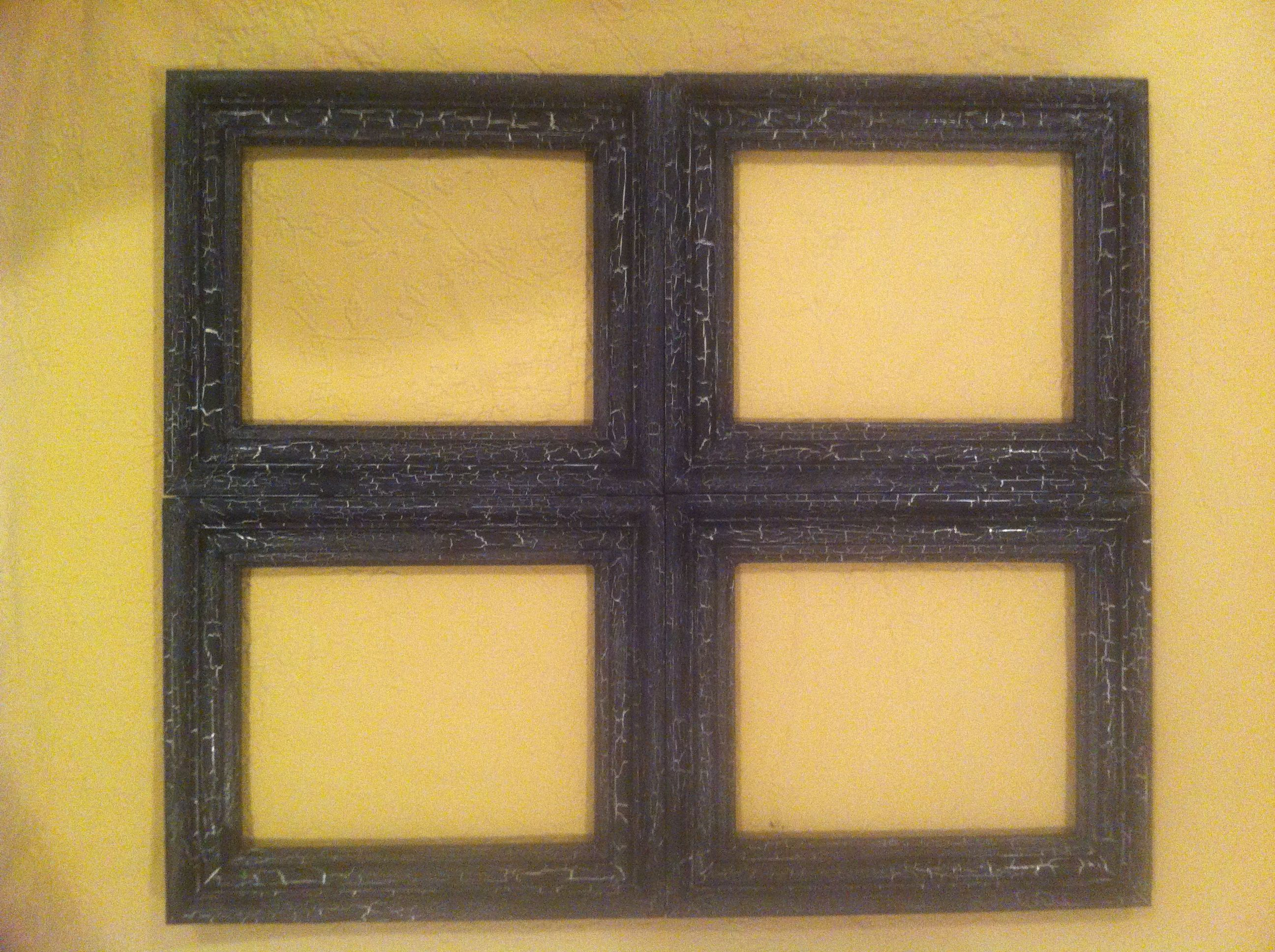 This is four 8X10 frames put together to make one. It has a black ...