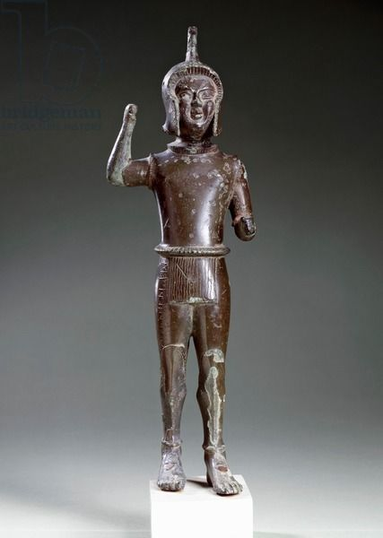 Etruscan bronze statue of an armored jawelin thrower from Ravenna. C.550BC. Leida Rijksmuseum Van Oudheden