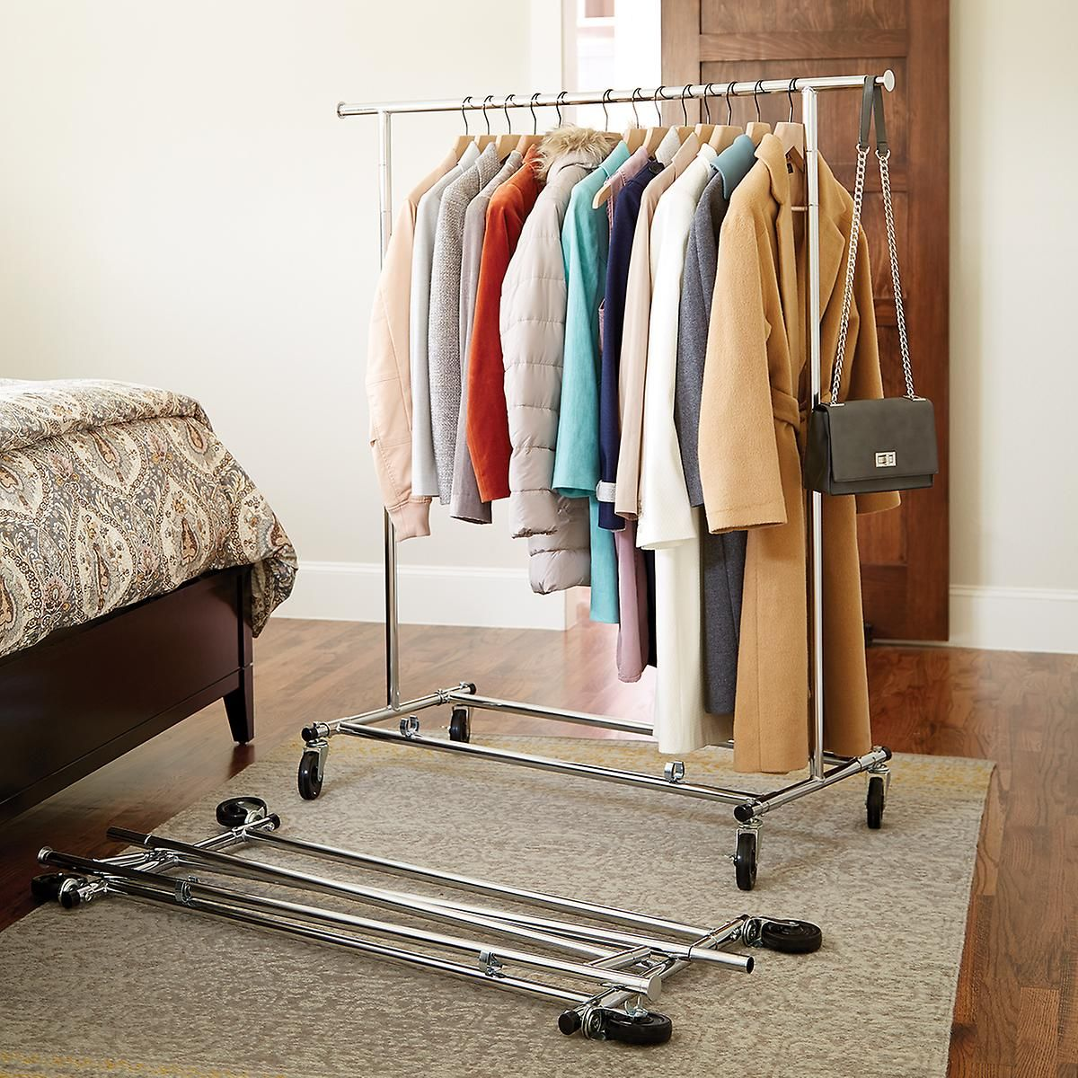 Chrome metal folding commercial clothes rack in divasroom