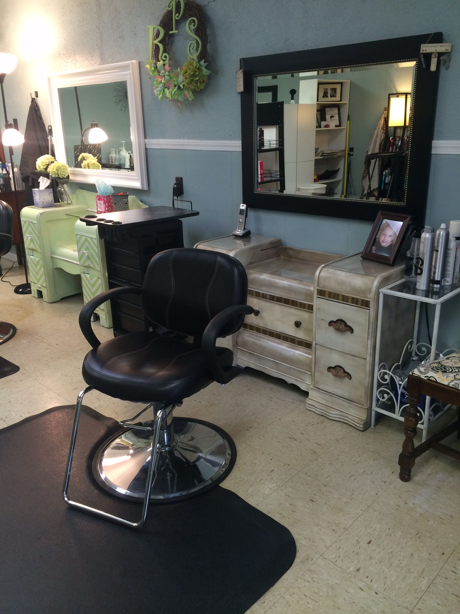 our custom distressed styling stations in the salon really bring a