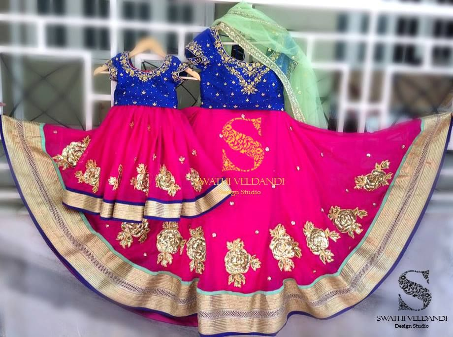 Like a blossom in the spring and in love with the pink. How bright is your Sunday going to be?  Look at the gorgeous pink lehenga paired with Royal blue blouse for both mom and daughter. E-mail:teamswathiveldandi@gmail.com call/watsapp:+918179668098