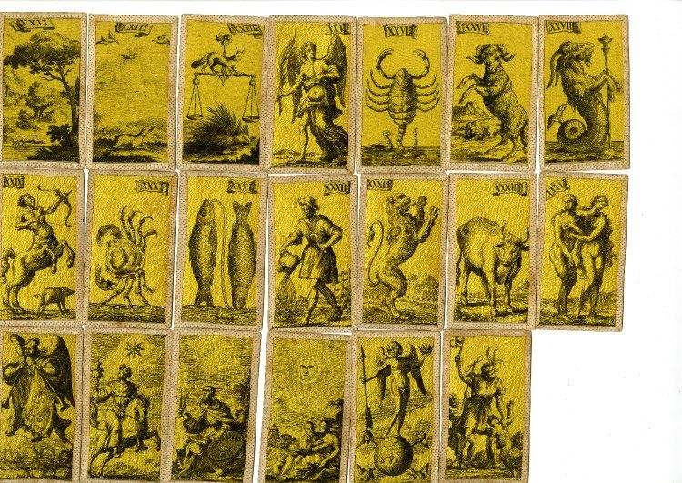 British Museum - A complete pack of 97 tarot cards, printed on yellow silk, for the Florentine tarot game, minchiate. Etching on silk Backs woodcut in black with the arms of the Medici family 18th Century