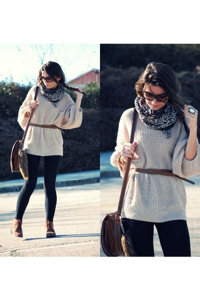 oversized sweater, belt, skinny jeans, and boots.