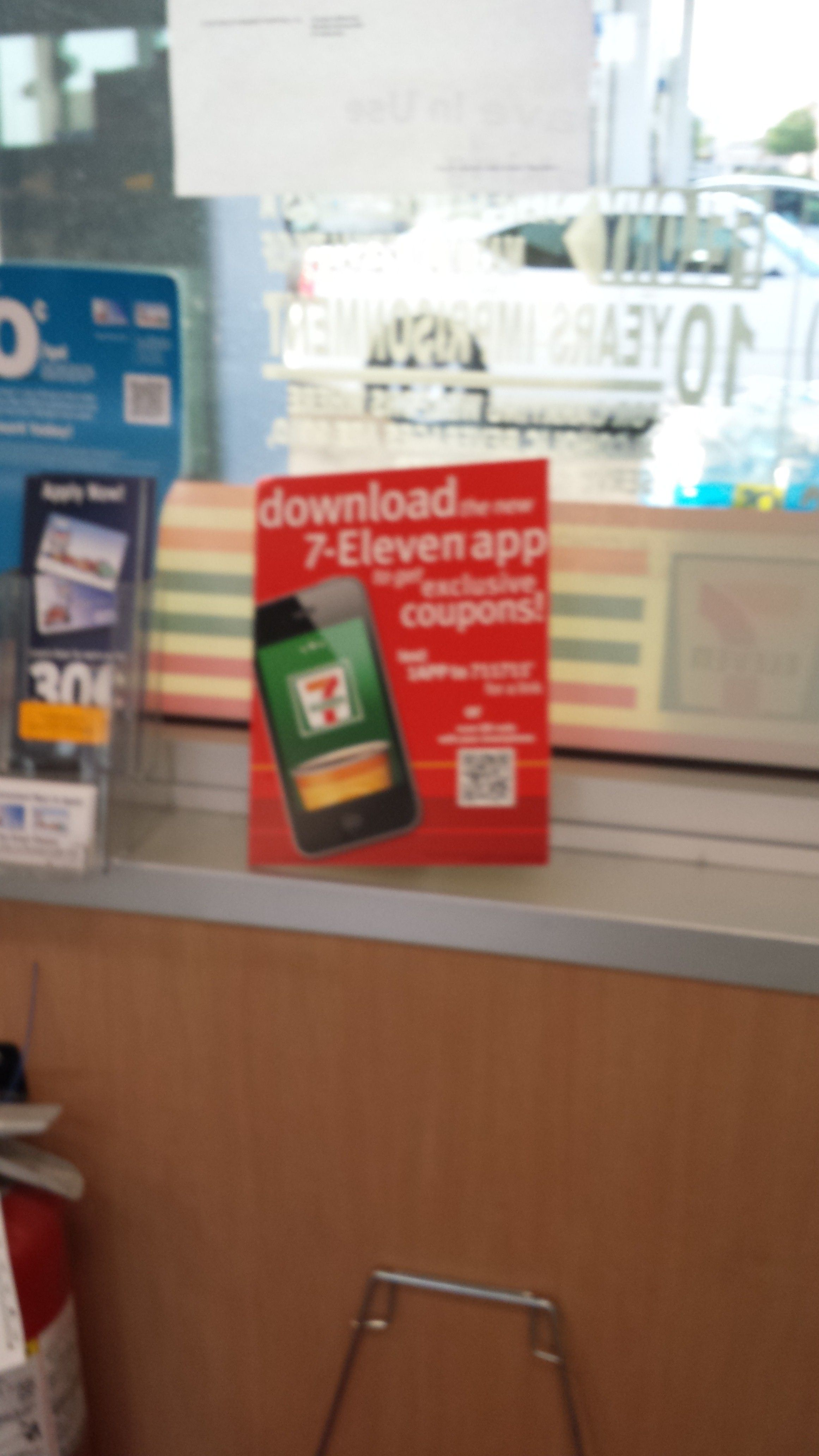 711 convenience stores are using this poster with a QR