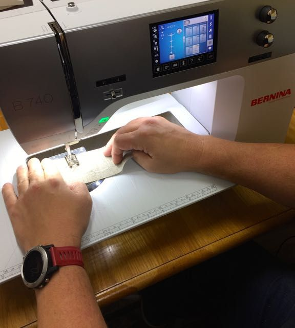 Mauritz demonstrating the new Bernina 740 that he bought for his mum - as a gift.  Hamilton, New Zealand, 2016