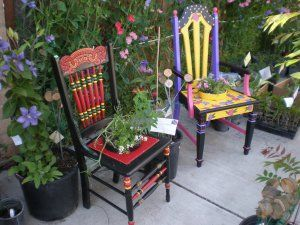 Painted Chairs in the Garden. Love the red and black one. I have the perfect chair for this!