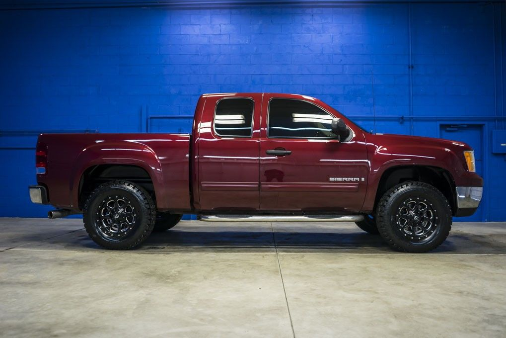 Clean Burgundy 2008 GMC Sierra 1500 SLE 4x4 Pickup truck with custom wheels and tires all For Sale At Northwest Motorsport