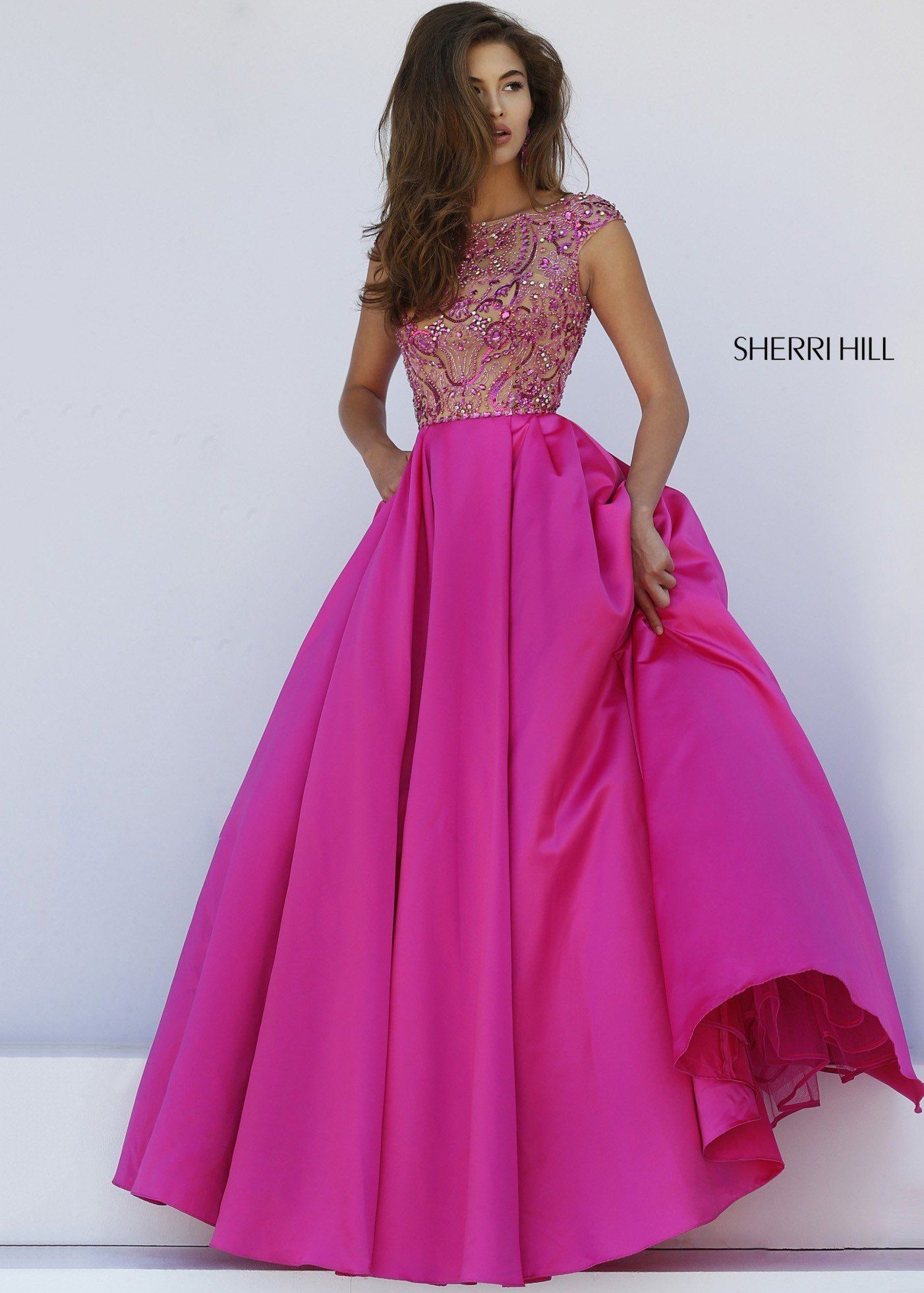 2a7f81133f5 Feel like a princess in this fabulous ball gown from Sherri Hill. The  stunning bodice has an illusion neckline and cap sleeves and is encrusted  with sparkly ...
