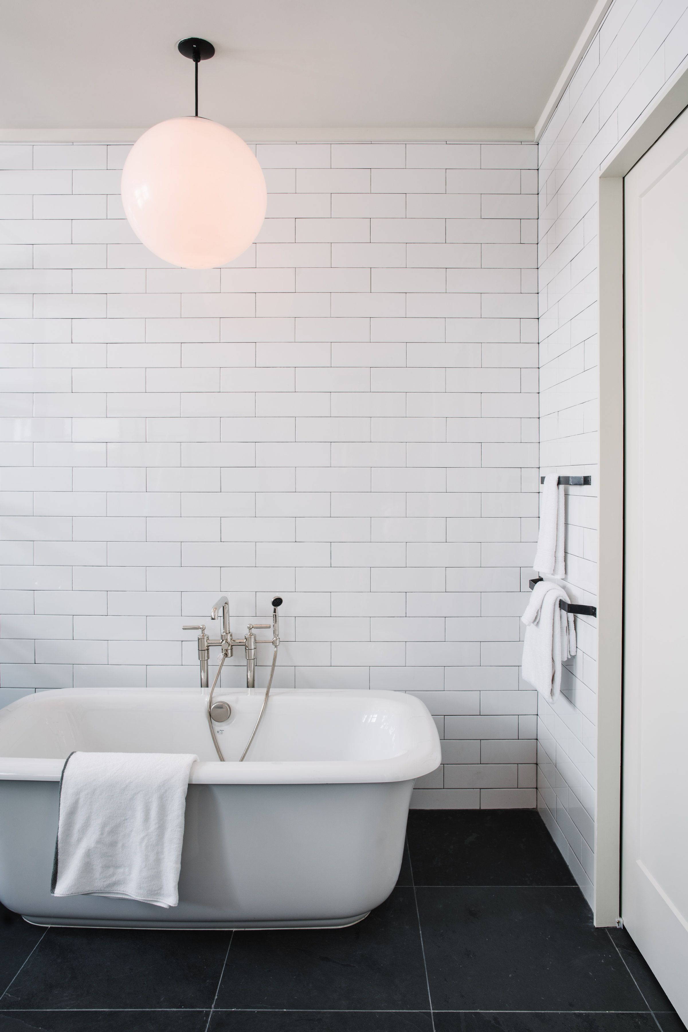 Simplistic minimalistic bathroom design with white subway tiled ...