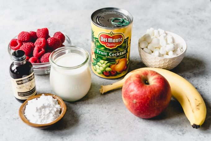 an image of a can of fruit cocktail with the other ingredients for making fruit salad with