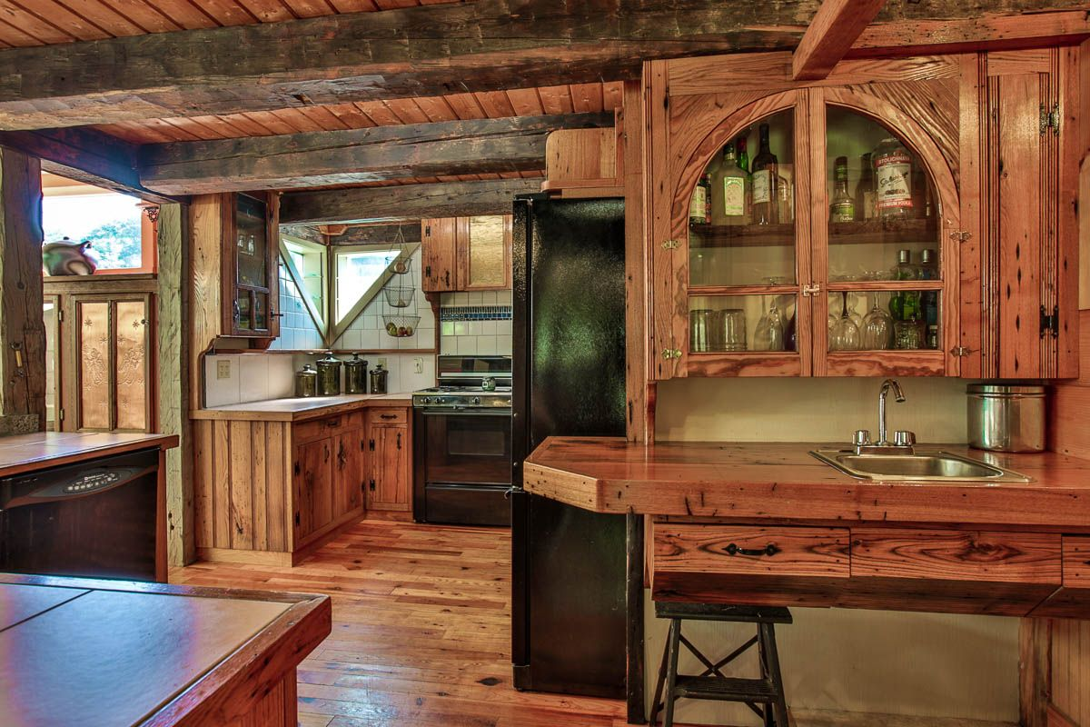 Hand hewn beams, american chestnut cabinets, wet bar, tons of counter space all add to the charm of this home in Andover, New Hampshire. Offered by the Hvizda Team at Keller Williams Metropolitan