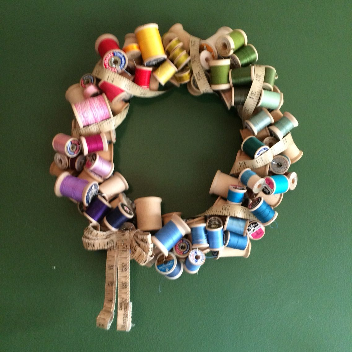My Vintage spool wreath. I wired old spools to a fabric