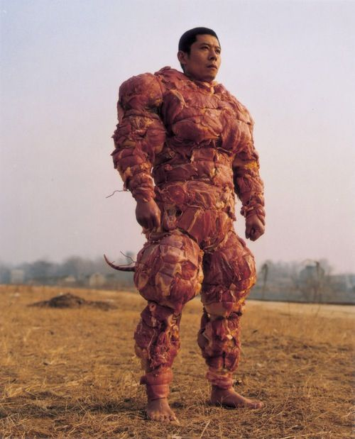 "Yes, it Exists: The Bacon Armor [Pic].    The picture's comment says, ""The perfect armor to wear if you have zero value for your life while travelling in a wolf/bear infested forest."""