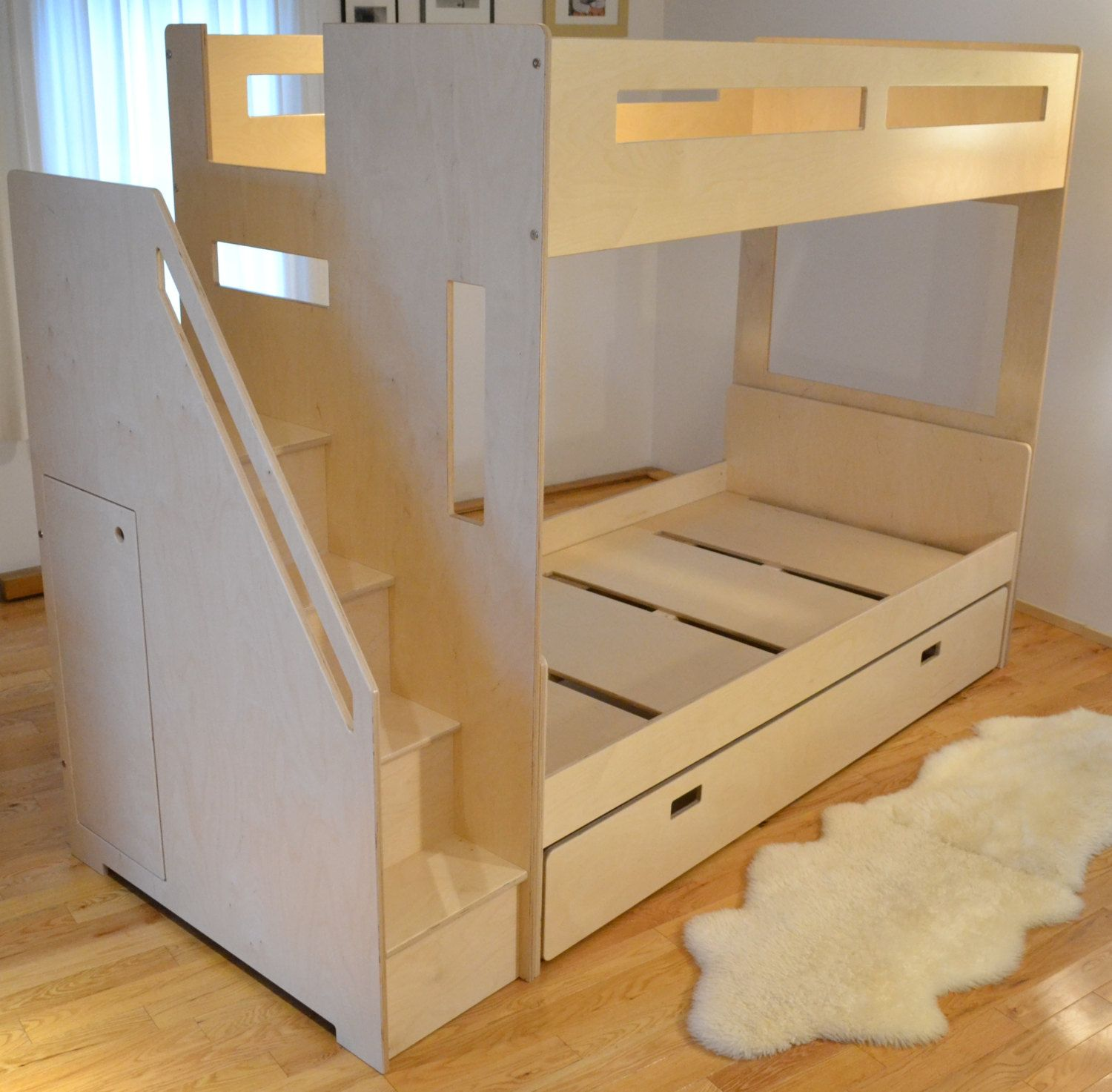 Loft bed nested with a twin bed and trundle Bunk beds