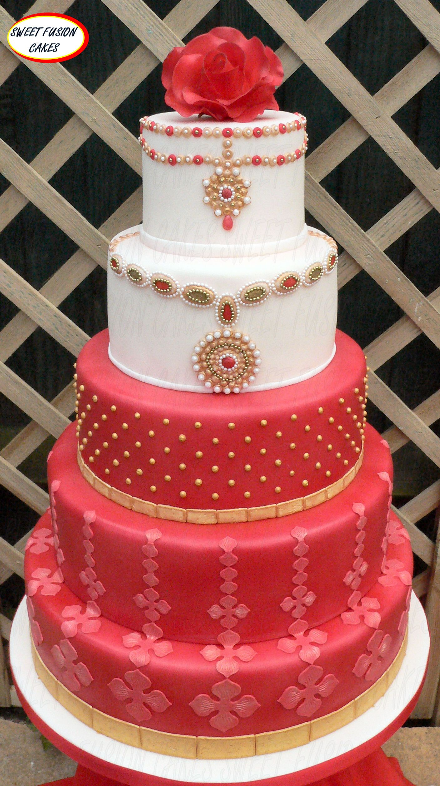 5 tiered wedding cake inspired by Asian Bridal fashion  With