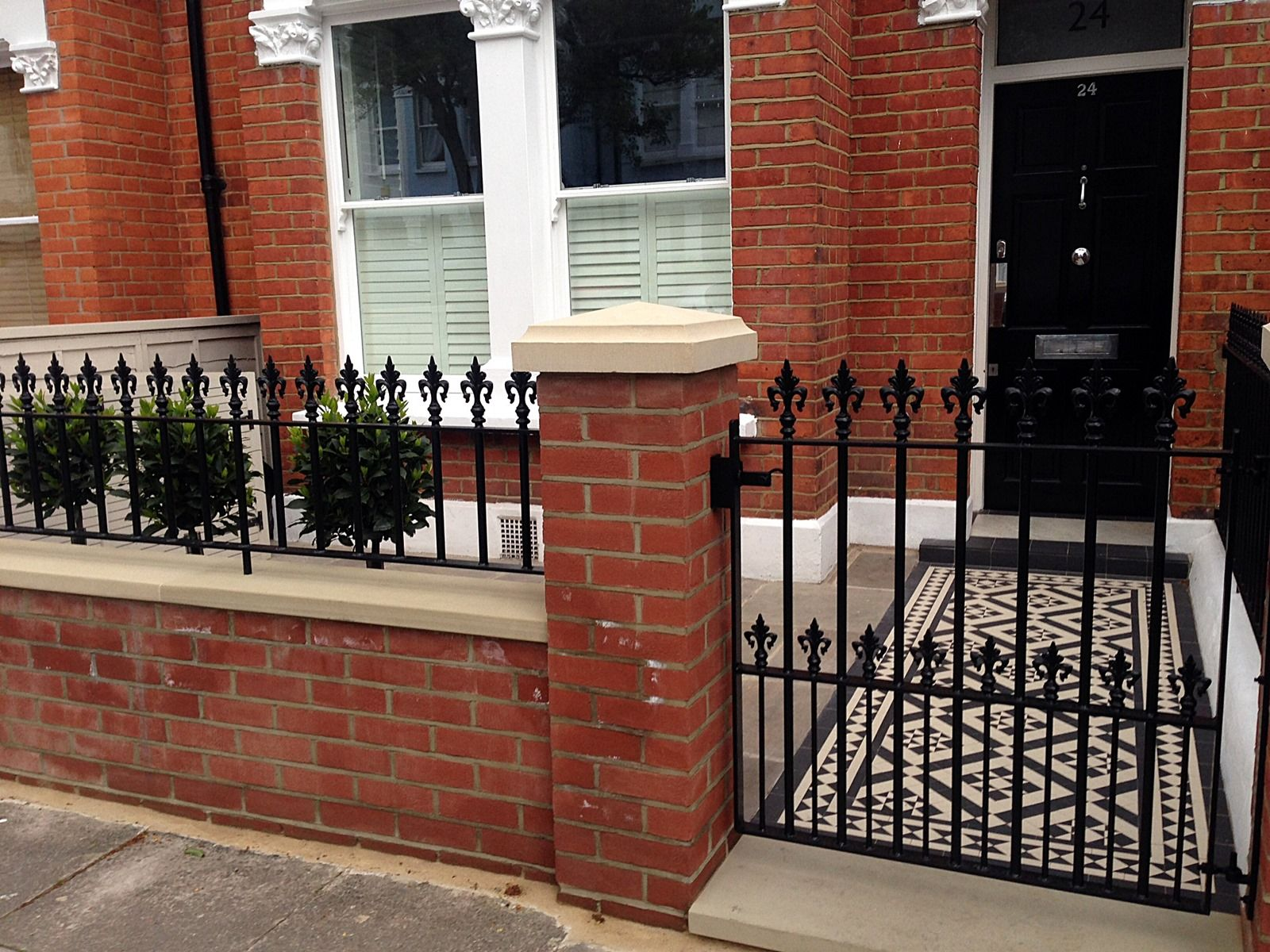 red brick front garden wall yellow stone caps sandstone paving
