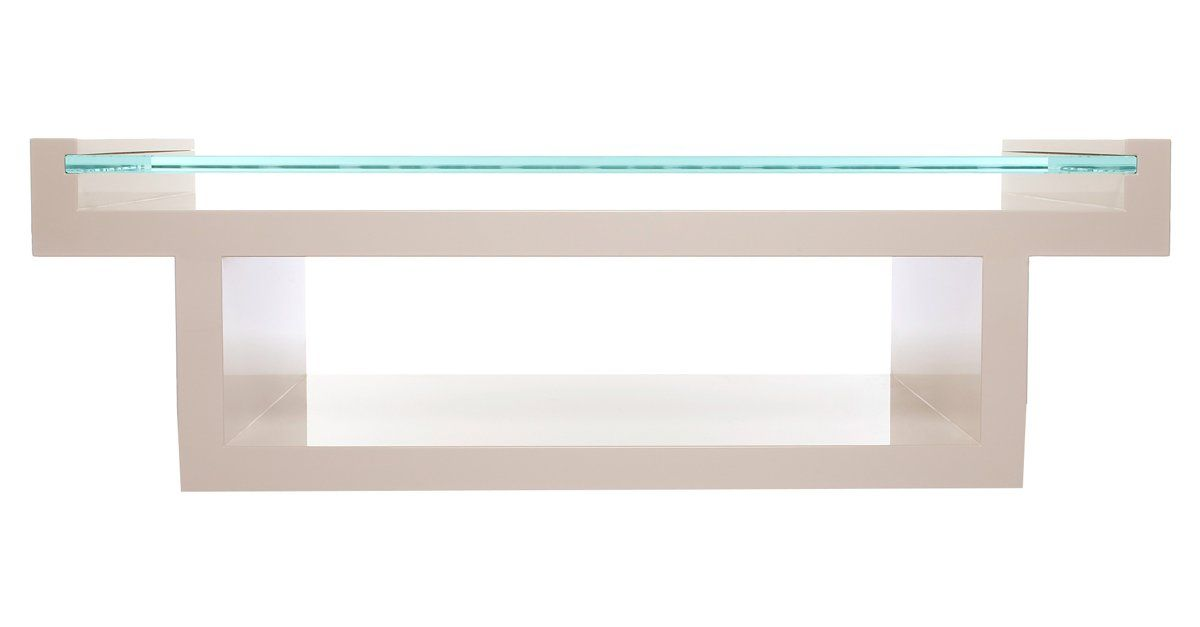 Crisp, clean lines and a glossy white lacquer deliver ultra mod appeal to this gleaming coffee table. An inset glass top provides a sleek surface for drinks, snacks, and home accents.