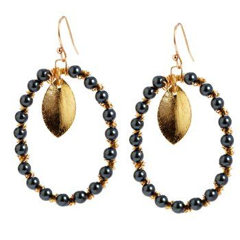 Tahitian Leaf Earrings, by Jolie Éclat. In this nature-inspired earring, a golden leaf dangles from a Swarovski Tahitian pearl wrapped oval. Available at ahalife.com