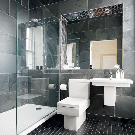 modern charcoal bathroom with glass wall and sink