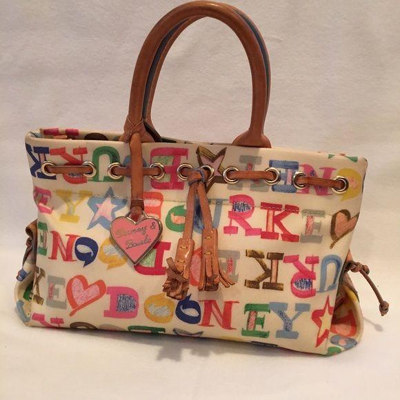 "Dooney & Bourke handbag Authentic Dooney & Bourke handbag 13""across 7"" tall and 5"" at base of bag several pockets inside bag good condition Dooney & Bourke Bags"