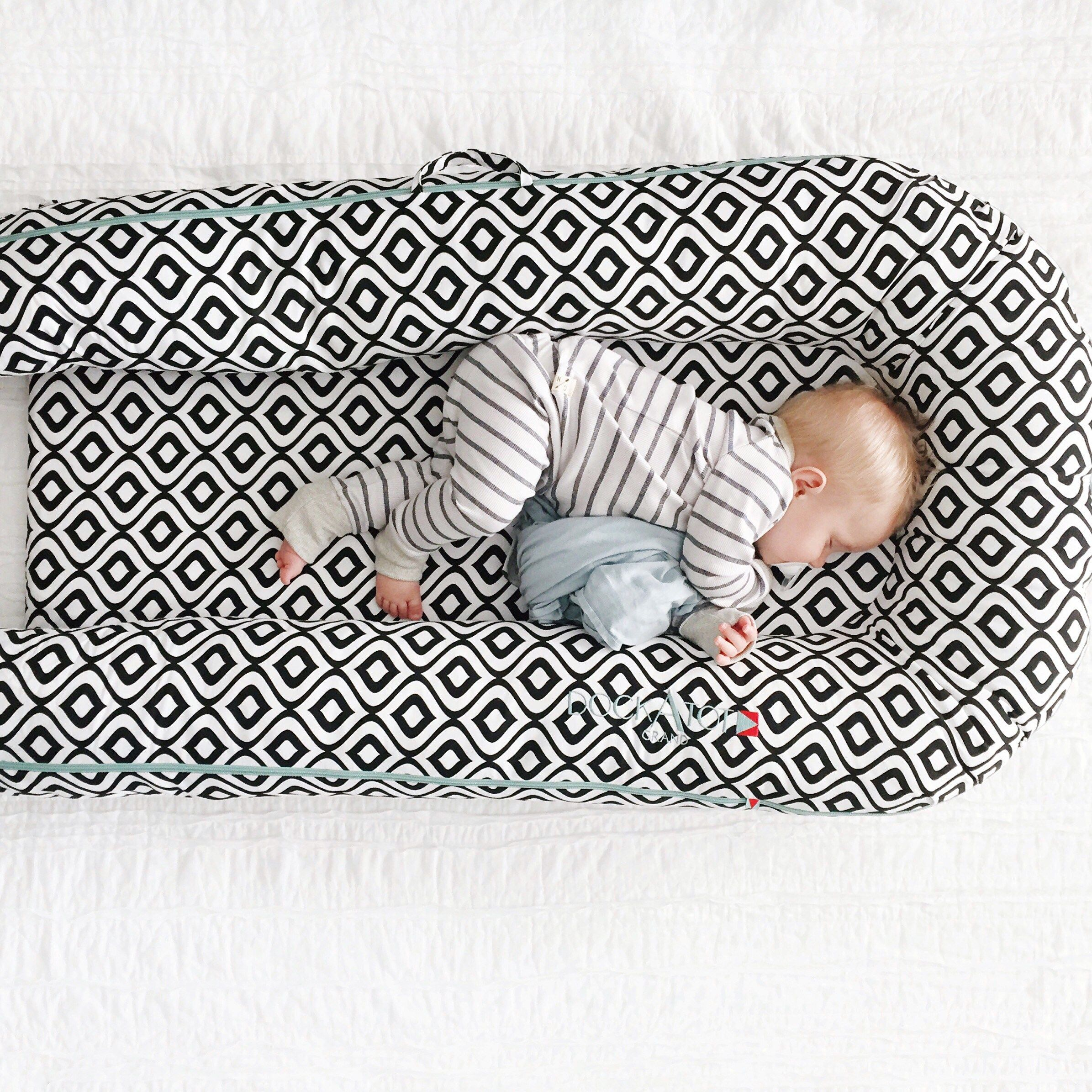 dockatot portable baby bed has helped a ton with travel we ve