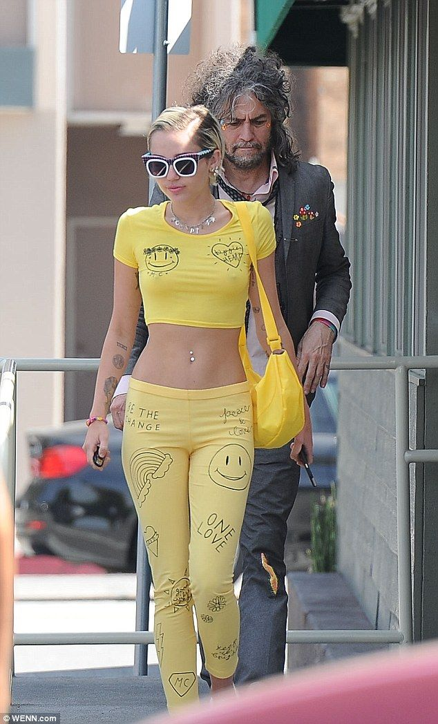 73ef537f585 Celebrity Style: Miley Cyrus goes braless in tiny yellow crop top and  matching leggings as she heads out for lunch
