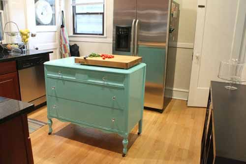 make a dresser into a kitchen island. put a cutting board on top.
