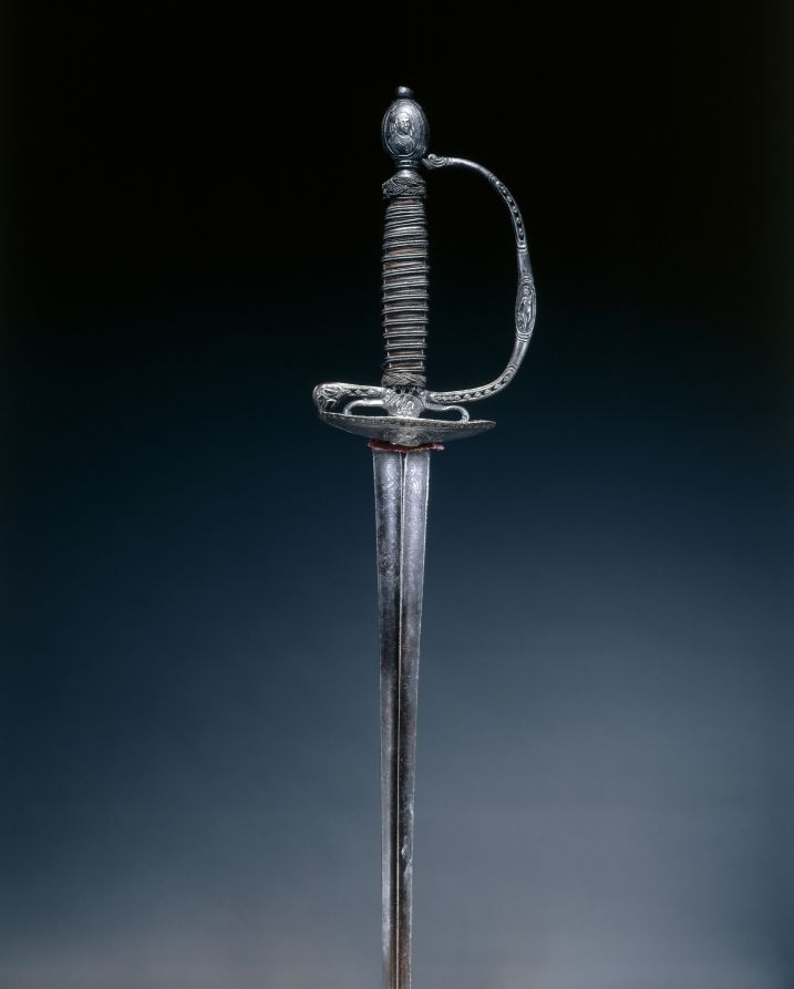 Small Sword, late 17th Century France, late 17th Century steel, chiseled and pierced; iron, wood; wire-bound grip, Overall - l:104.10 cm (l:40 15/16 inches) Wt: .36 kg Blade - l:87.60 cm (l:34 7/16 inches) Guard - w:7.90 cm (w:3 1/16 inches).