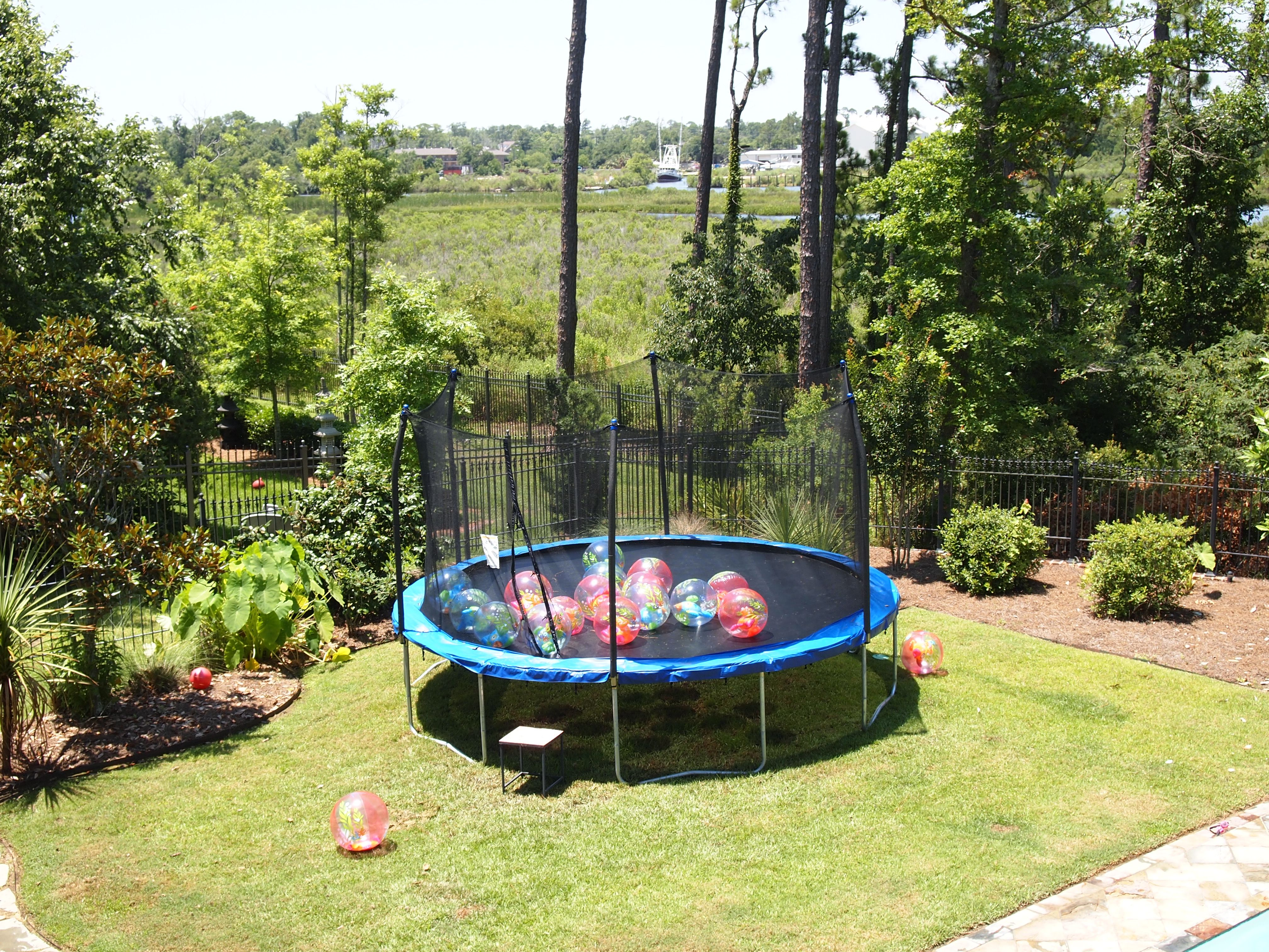 trampoline filled with beach balls pool and waterslide were fun