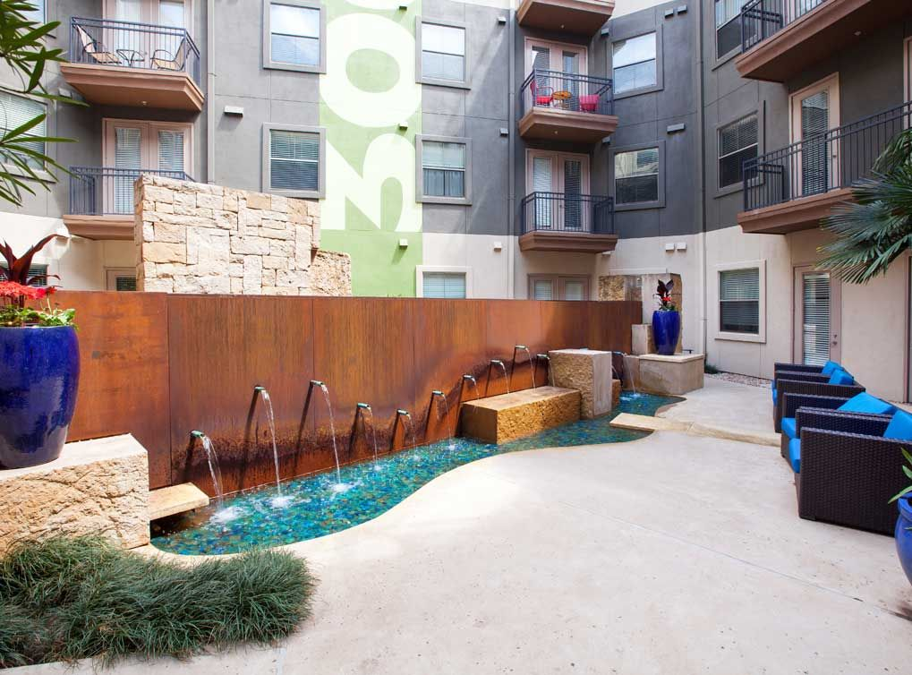Relaxing Courtyard With Fountain At Amli 300 A Luxury Apartment Community In Downtown Austin Austin Apartment Luxury Apartments Apartment