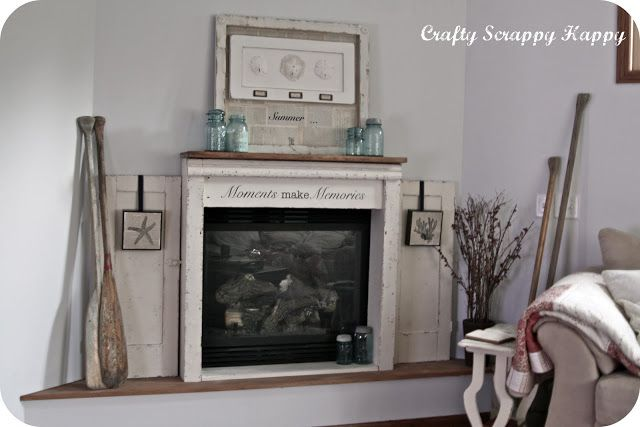 DIY mantle out of an old cabinet