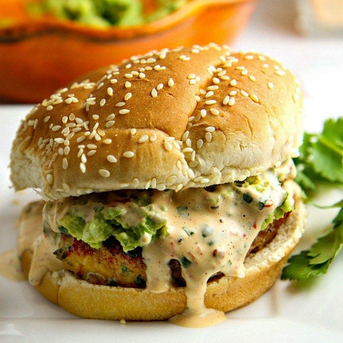 Add a Tex-Mex flair to your next summer BBQ! This Avocado Chicken Burger is LOADED with flavor, grilled to perfection, piled high with smashed avocado and smothered in chipotle mayo...perfect recipe for the grilling season!